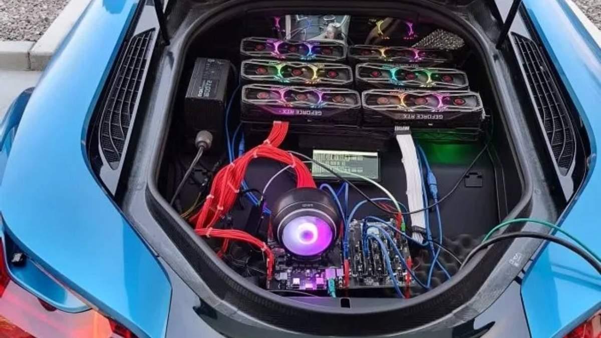 В багажнике BMW i8 установили майнингову ферму: фото